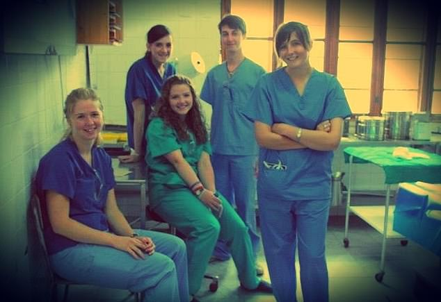 Alexandra (pictured right) with her fellow medical students at Cardiff University