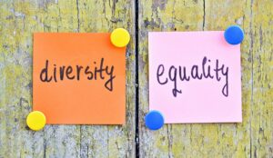 """Picture of two sticky notes that say """"diversity"""" and """"equality""""."""