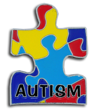 """Picture of a puzzle piece with the word """"autism"""" inside of it."""