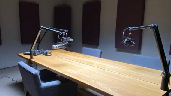 A Life Worth Living Episode 1 Clutch Media Podcast Studio with Chair, Table, Microphones and sound proof walls.